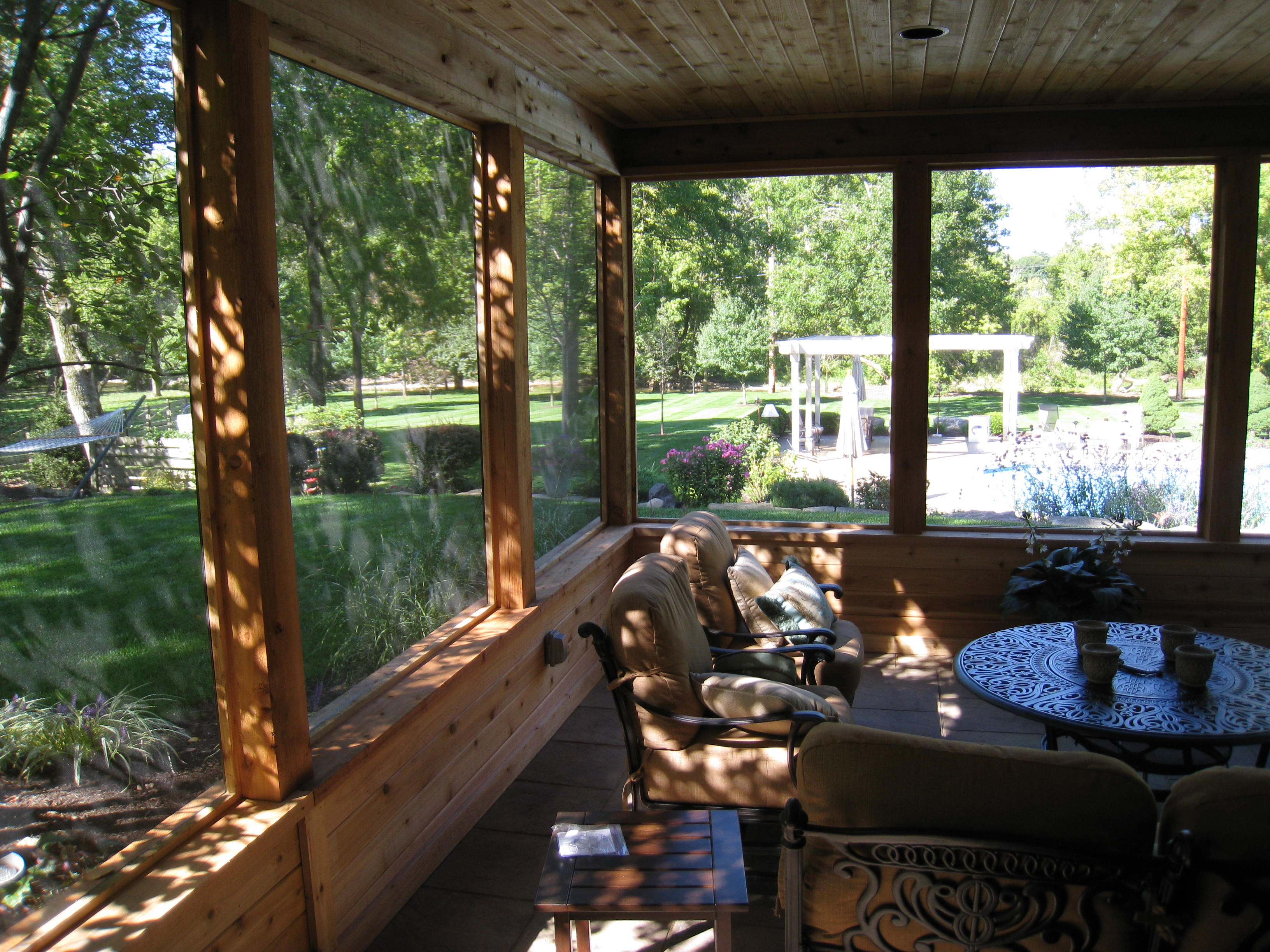 Top 10 reasons for building a screen porch columbus for Rustic porches and decks