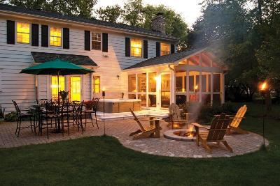 Beautiful View Of Screened Porch And Patio At Dusk