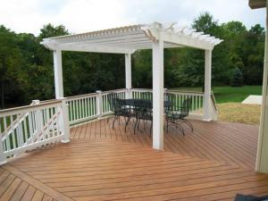 Vinyl pergolas have leuvered slats