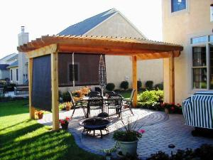Screens or backyard blinds installed in pergola by Archadeck of Columbus