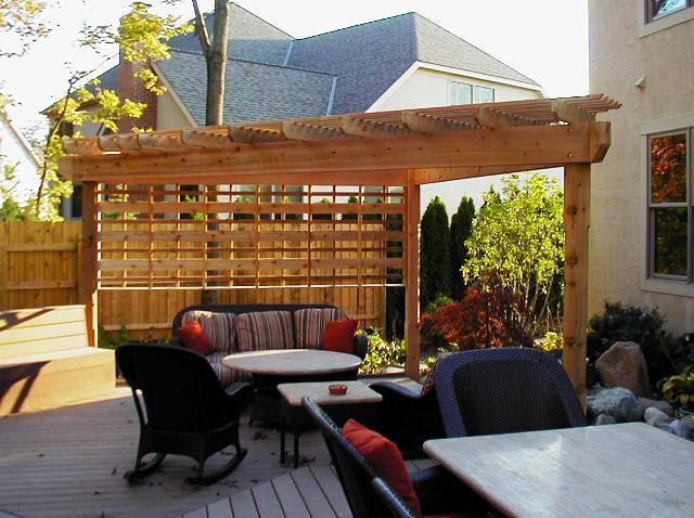 pergola incorporated into a privacy fence