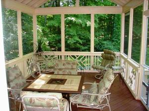 This Columbus, OH screened porch shows the use of a decorative divider rail and post patterns