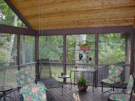 Screened porch divider rail with floor of diagonal decking boards