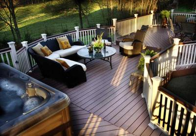 This stunning hot tub deck takes curves to a new level