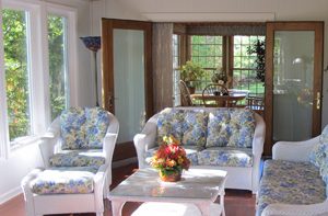Notice how this sunroom flows effortlessly to and from the existing homes interior through these stunning french doors.