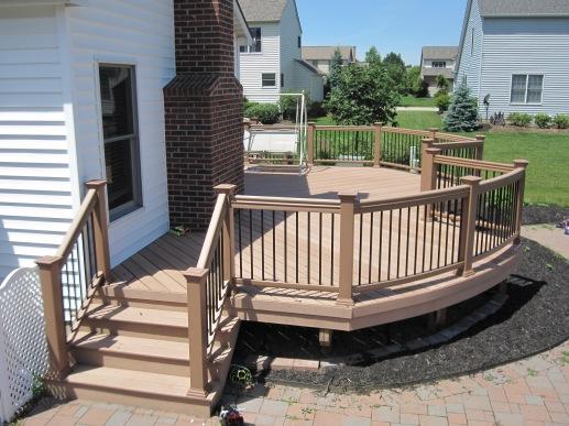 TimberTech Twin Finish Cedar color deck with curved TimberTech ornamental rail
