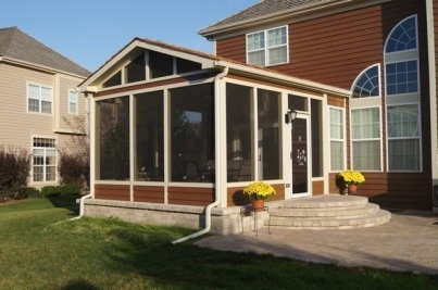 Gable roof Screen Porch with paved floor and adjacent patio