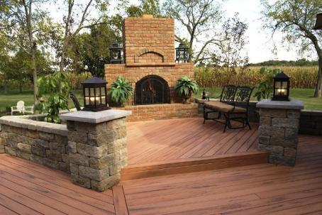 This beautiful Tiger Wood colored custom multi-level composite deck with an outdoor fireplace creates a comfortable outdoor living space.