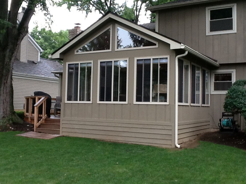 This Outdoor Living Deck And 3 Season Room Combination In