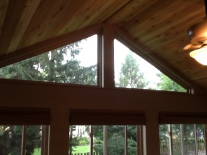 Detailed image of the dual trapezoid windows and beautiful tongue and groove ceiling on the interior.
