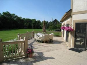 This is the before image of the same deck pictured above. The original deck was built using cedar.