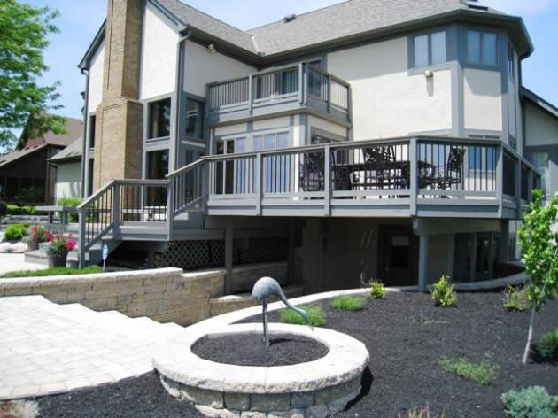 The design was changed and allowed for better traffic flow, especially with the addition of the paver patio. Timbertech Earthwood Decking was installed with a Cedar Railing including black aluminum pickets.