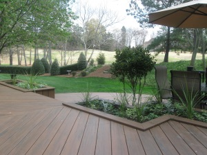 Earthwoods Evolutions with planters looking at golf course