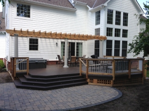 TimberTech legacy deck in mocha. Patio compliments deck and house trim.