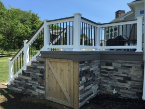 Columbus deck with stackstone skirting and beautiful storage door lr