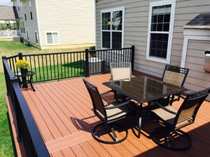 Composite and synthetic woods have come a long way baby. Look at the stunning color of this deck.